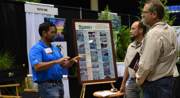 Native plant grower talking with industry professionals